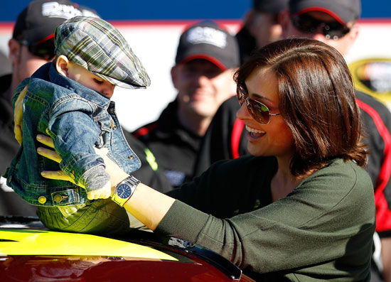 Jeff Gordon's wife Ingrid Vandebosch and his son Leo in victory lane after Jeff Gordon secured a front row start for the Daytona 500 at Daytona International Speedway in Daytona Beach, Fla. (Credit: Chris Graythen/Getty Images for NASCAR)