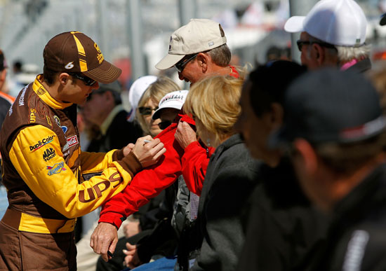 David Ragan signs a fans jacket during Daytona 500 Qualifying at Daytona International Speedway in Daytona Beach, Fla. (Credit: Tom Pennington/Getty Images for NASCAR)