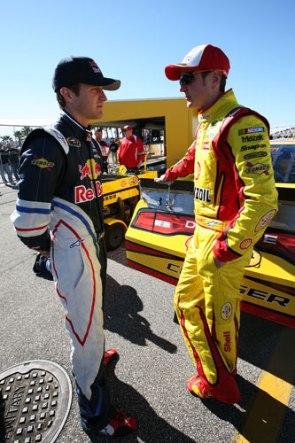Kasey Kahne and Kurt Busch discuss practice Saturday at Daytona International Speedway in Daytona Beach, Fla. (Credit: Jerry Markland/Getty Images for NASCAR)