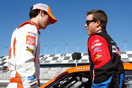 Joey Logano and Trevor Bayne talk during Daytona 500 practice at Daytona International Speedway in Daytona Beach, Fla. (Credit: Todd Warshaw/Getty Images for NASCAR)