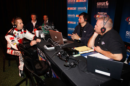 NASCAR Sprint Cup Series driver Greg Biffle talks with Pete Pistone and Mike Bagley from The Morning Drive on Sirius during media day Thursday at Daytona International Speedway in Daytona Beach, Fla. (Credit: Todd Warshaw/Getty Images for NASCAR)