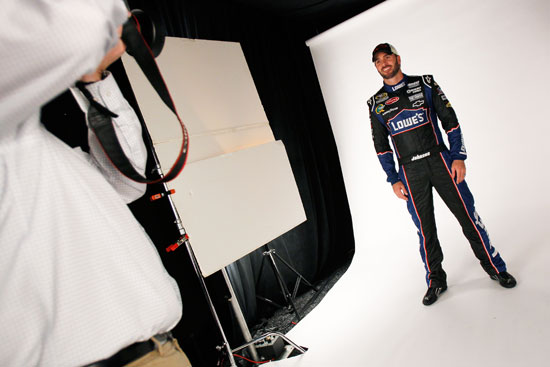 NASCAR Sprint Cup Series driver Jimmie Johnson poses for photos Thursday at Daytona International Speedway in Daytona Beach, Fla. during media day. (Credit: Todd Warshaw/Getty Images for NASCAR)
