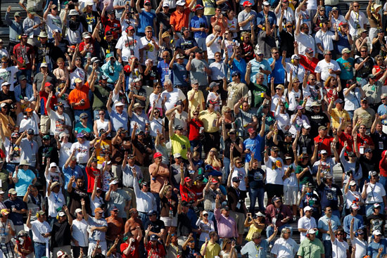 The fans salute Dale Earnhardt on lap 3 by holding up three fingers during the Daytona 500 at Daytona International Speedway at Daytona Beach, Fla. (Credit: Todd Warshaw/Getty Images for NASCAR)
