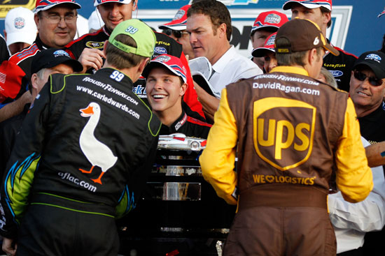 Carl Edwards and David Ragan congratulate Trevor Bayne in victory lane after the 53rd Daytona 500 at Daytona International Speedway in Daytona Beach, Fla. (Credit: Matthew Stockman/Getty Images for NASCAR)