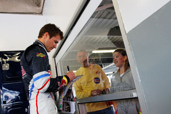 Kasey Kahne signs autographs for fans in the garage Wednesday at Daytona International Speedway in Daytona Beach, Fla. (Credit: Jason Smith/Getty Images for NASCAR)