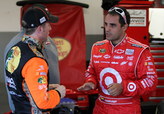 2010 Daytona 500 Champion Jamie McMurray and teammate Juan Pablo Montoya share information during Budweiser Shootout practice at Daytona International Speedway in Daytona Beach, Fla. (Credit: Nick Laham/Getty Images)