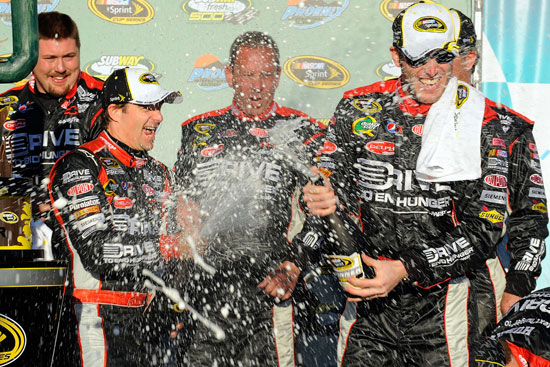 Jeff Gordon douses new crew chief Alan Gustafson with champagne after ending his 66-race winless streak with his SUBWAY Fresh Fit 500 victory. (Credit: Jared C. Tilton/Getty Images for NASCAR)