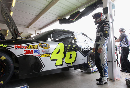 Five-time defending NASCAR Sprint Cup Series driver Jimmie Johnson looks on as his team adjusts his No. 48 Lowe's Chevrolet during practice for the SUBWAY Fresh Fit 500 at Phoenix International Raceway. (Credit: Christian Peterson/Getty Images)