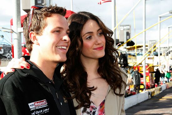 Actress Emmy Rossum, who sang the national anthem, poses with Daytona 500 champion Trevor Bayne before getting a ride around Phoenix International Raceway. (Credit: Chris Graythen/Getty Images)