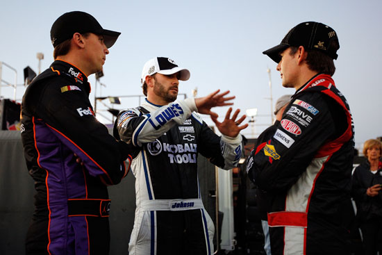 Denny Hamlin, Jimmie Johnson and Jeff Gordon discuss practice at Daytona International Speedway in Daytona Beach, Fla. (Credit: Chirs Graythen/Getty Images for NASCAR)