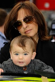 Ingrid Vandebosch, wife of Jeff Gordon, with their son Leo before the start of the Jeff Byrd 500 at Bristol Motor Speedway