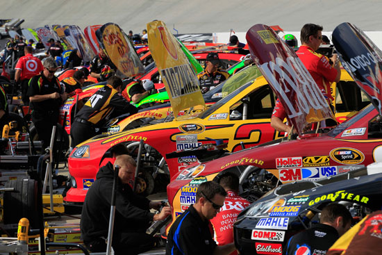 Crew Members working on pit road during NASCAR Sprint Cup Series practice at Bristol Motor Speedway (Credit: Chris Trotman/Getty Images)