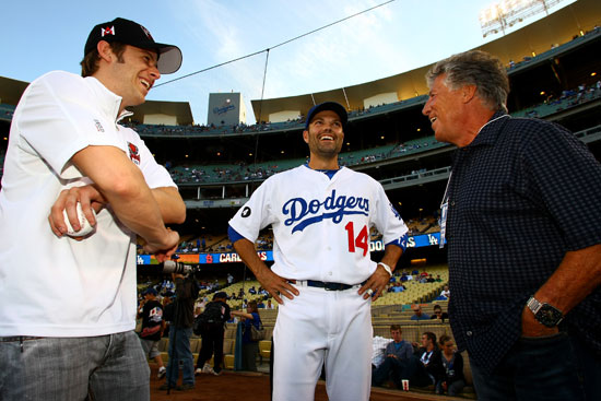 Marco Andretti (left) and his grandfather, Mario (far right) chat with Los Angeles Dodger shortstop Jamey Carroll before the start of the Dodgers game vs the St. Louis Cardinals on Friday, April 15th, 2011