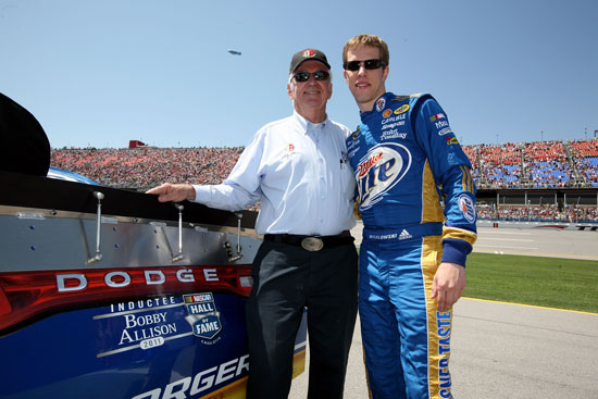 2011 Hall of Fame Inductee Bobby Allison on pit road with Brad Keselowski before the start of the Aaron's 499 at Talladega Superspeedway (Credit: Jerry Markland/Getty Images for NASCAR)