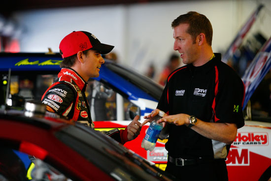 Jeff Gordon, driver of the No. 24 Drive to End Hunger Chevrolet, talks with crew chief Alan Gustafson at Talladega (Ala.) Superspeedway. (Courtesy of Hendrick Motorsports)