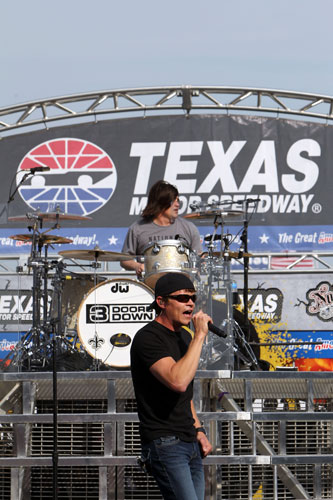 Lead singer Brad Arnold and drummer Greg Upchurch of 3 Doors Down perform prior to the NASCAR Sprint Cup Series Samsung Mobile 500 at Texas Motor Speedway on Saturday in Fort Worth, Texas. (Credit: Jonathan Ferrey/Getty Images for NASCAR)