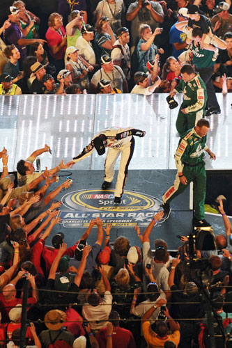 Dale Earnhardt Jr. greets his fans after being announced as the Sprint Fan Vote winner which transferred him into his 12th straight NASCAR Sprint All Star Race. (Credit: Drew Hallowell/Getty Images for NASCAR)
