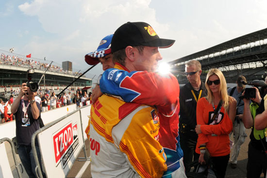 Ryan Hunter Reay gets a hug from Graham Rahal while his Ryan's fiancee, Beccy Gordon, looks on.