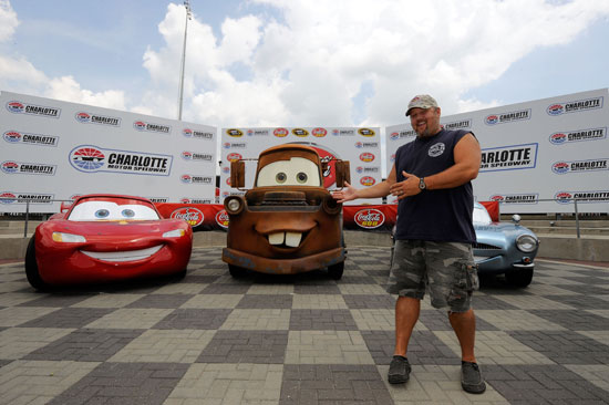 Larry the Cable Guy the voice of Mater poses with other stars from the upcoming Pixar film Cars 2 Sunday at Charlotte Motor Speedway. (Credit: John Harrelson/Getty Images for NASCAR)