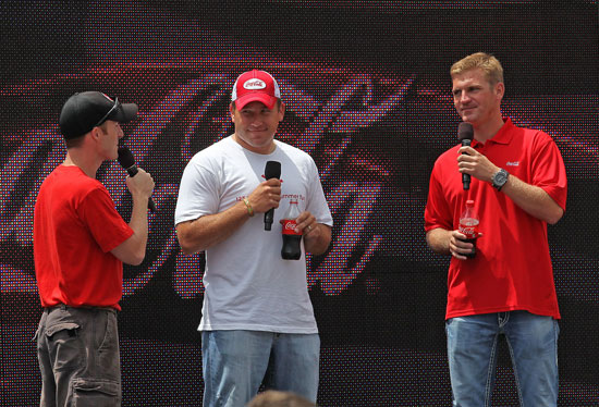 NASCAR Sprint Cup Series drivers Clint Bowyer (right) and Ryan Newman (center) answer fan questions during a Q&A at the Coca-Cola Track Walk and Summer Celebration Cookout on Friday at Charlotte Motor Speedway in Concord, N.C. (Credit: HHP)