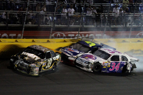 Ryan Newman, Mark Martin and David Gilliland get tangled up on lap 301 during the Coca-Cola 600 at Charlotte Motor Speedway (Credit: Jerry Markland/Getty Images for NASCAR)