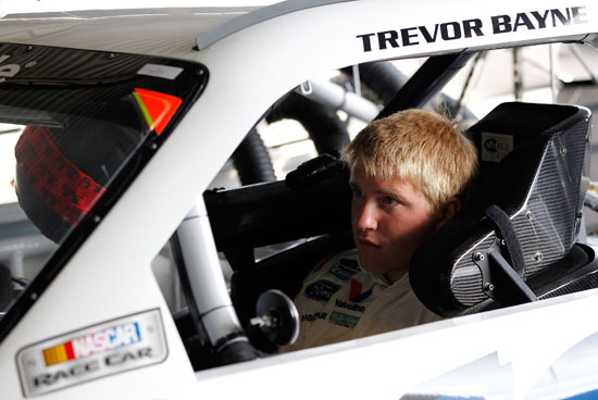 Chris Buescher, driver of the No. 16 Roush Fenway Racing Ford, sits in the car normally driven by Trevor Bayne, in the garage during practice for the NASCAR Nationwide Series Royal Purple 200 at Darlington Raceway on May 6 in Darlington, S.C. (Credit: Geoff Burke, Getty Images for NASCAR)