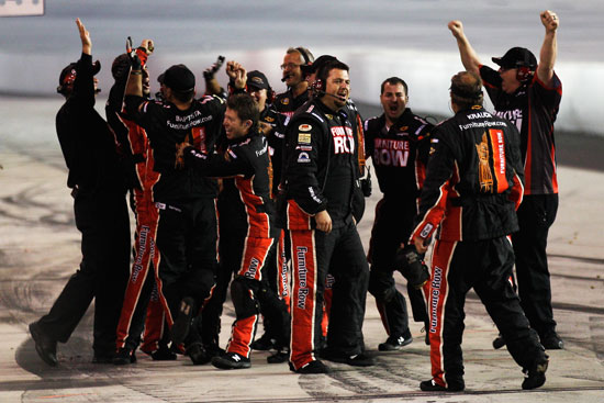 The No.78 team celebrates Regan Smith and Furniture Row's first NASCAR Sprint Cup Series victory at Darlington Raceway (Credit: Chris Graythen/Getty Images for NASCAR)