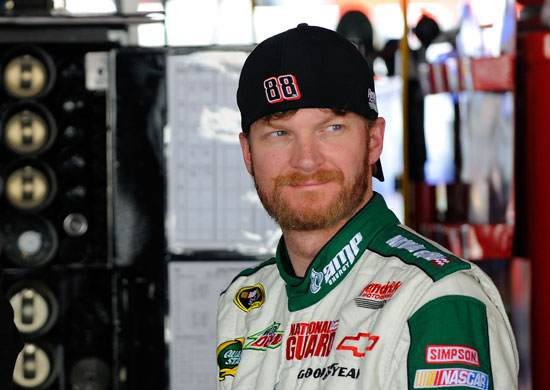 Dale Earnhardt Jr., driver of the No. 88 Amp Energy Sugar Free and National Guard Chevrolet, stands in the garage during practice for the NASCAR Sprint Cup Series FedEx 400 Benefiting Autism Speaks at Dover International Speedway on May 13 in Dover, Del. (Credit: Jared C. Tilton, Getty Images for NASCAR)