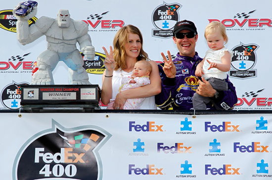 Accepting the Miles the Monster trophy in Sunoco Victory Lane are Katie and Matt Kenseth and their daughter Kaylin Nicola after winning the NASCAR Sprint Cup Series race on Sunday at Dover International Speedway in Dover, Del. (Credit: Todd Warshaw/Getty Images for NASCAR)