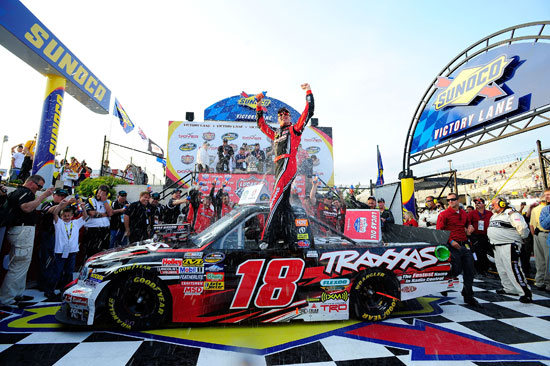 Kyle Busch and the No. 18 Kyle Busch Motorsports team celebrate after winning the NASCAR Camping World Truck Series Lucas Oil 200 on Friday at Dover International Speedway in Dover, Del. (Credit: Jason Smith/Getty Images for NASCAR)