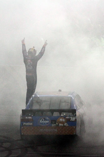 Kyle Busch salutes the fans after winning the Crown Royal presents the Matthew and Daniel Hansen 400 at Richmond International Raceway. (Credit: Jerry Markland/Getty Images for NASCAR)