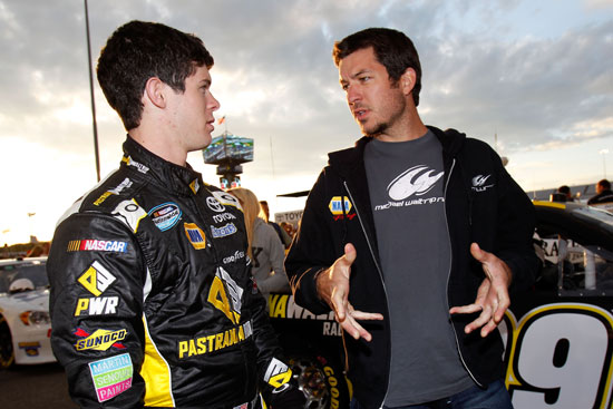 Ryan Truex gets advice from older brother Martin before the start of the the BUBBA Burger 250 at Richmond International Raceway. Truex ended up posting his first career top-10 finish. (Credit: Todd Warshaw/Getty Images for NASCAR)