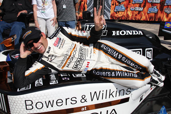 Alex Tagliani celebrates winning the pole for the first of the two Firestone Twin 275s
