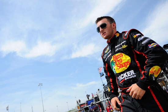 Austin Dillon walks through the Kansas Speedway garage on Friday in Kansas City, Kansas. Dillon was fastest in NASCAR Camping World Truck Series final practice, turning a lap at 32.819 seconds/164.539 mph. (Credit: Jared C. Tilton/Getty Images for NASCAR)