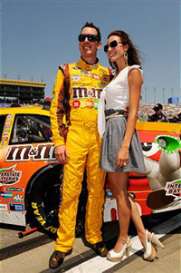Kyle Busch, driver of the #18 M&amp;M&#039;sToyota, and his wife Samantha Sarcinella take part in pre-race ceremonies for the NASCAR Sprint Cup Series STP 400 at Kansas Speedway on June 5, 2011 in Kansas City, Kansas. (Photo by John Harrelson/Getty Images for NASCAR)