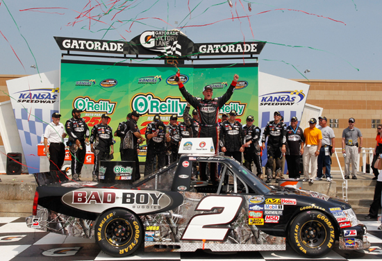 Clint Bowyer climbs out of the No. 2 Bad Boy Buggies Chevrolet in victory lane after winning the O&#039;Reilly Auto Parts 250 at Kansas Speedway (Credit: Geoff Burke/Getty Images for NASCAR)