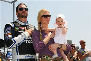 Jimmie Johnson, driver of the #48 Lowe's Chevrolet, his daughter Genevieve Marie and his wife Chandra take part in pre race ceremonies for the NASCAR Sprint Cup Series STP 400 at Kansas Speedway on June 5, 2011 in Kansas City, Kansas. (Photo by Tim Umphrey/Getty Images for NASCAR)