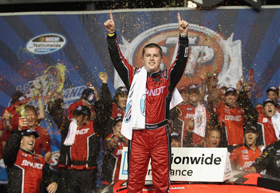 Justin Allgaier celebrates his second career NASCAR Nationwide Series win in Chicagoland Speedway&#039;s Victory Lane on Saturday in Joliet, Ill. (Credit: Jonathan Daniel/Getty Images for NASCAR)