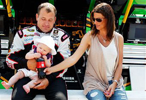 Ryan Newman, driver of the #39 Haas Automation Chevrolet, his wife Krissie Newman and their daughter Brooklyn Sage Newman sits together prior to the NASCAR Sprint Cup Series STP 400 at Kansas Speedway on June 5, 2011 in Kansas City, Kansas. (Photo by Geoff Burke/Getty Images for NASCAR)