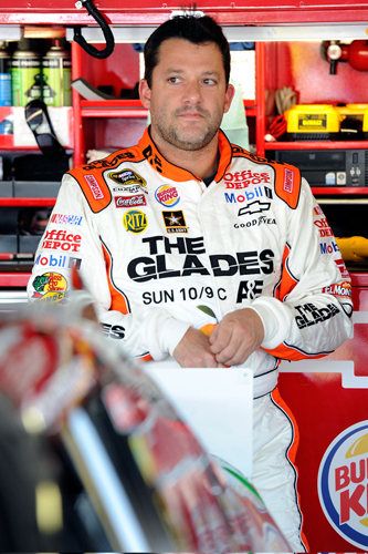 "Riding with primary sponsor ""The Glades,"" premiering Sunday on A&E, Tony Stewart was fourth-fastest in Friday's first NASCAR Sprint Cup Series practice at Kansas Speedway in Kansas City, Kan. (Credit: John Harrelson/Getty Images for NASCAR)"