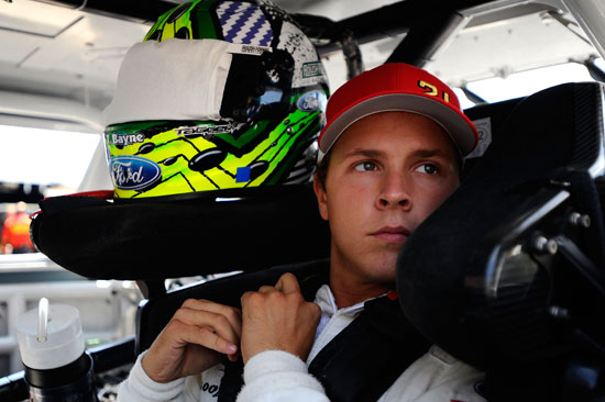 Trevor Bayne gets behind the wheel of his NASCAR Nationwide Series car during practice at Michigan International Speedway on Friday. Bayne returns to the NASCAR Sprint Cup Series this week for the first time in nearly two months. (Credit: Jason Smith/Getty Images for NASCAR)