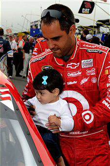 Juan Pablo Montoya, driver of the #42 Target Chevrolet, holds his daughter Manuela on the grid prior to the NASCAR Sprint Cup Series 5-Hour Energy 500 at Pocono Raceway on June 12, 2011 in Long Pond, Pennsylvania. (Photo by John Harrelson/Getty Images)