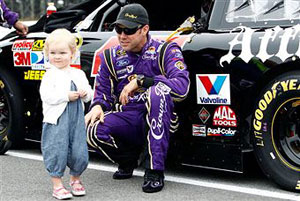 Matt Kenseth, driver of the #17 Affliction Clothing: Live Fast Ford, stands at his car with his daughter Kaylin Nicola during the NASCAR Sprint Cup Series 5-Hour Energy 500 at Pocono Raceway on June 12, 2011 in Long Pond, Pennsylvania. (Photo by Jeff Zelevansky/Getty Images for NASCAR)