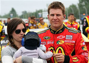Jamie McMurray, driver of the #1 McDonald's Chevrolet, his wife Christy and child Carter Scott stand on the grid during pre-race ceremonies for the NASCAR Sprint Cup Series 5-Hour Energy 500 at Pocono Raceway on June 12, 2011 in Long Pond, Pennsylvania. (Photo by Jerry Markland/Getty Images for NASCAR)