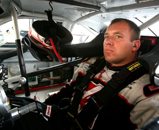 Ryan Newman, driver of the No. 39 Haas Automation Chevrolet, sits in his car in the garage during practice for the NASCAR Sprint Cup Series 5-Hour Energy 500 at Pocono Raceway on June 10 in Long Pond, Pa. (Credit: Jerry Markland/Getty Images)