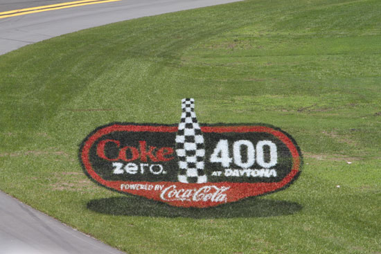 The innovative 3D turf logo on the grass apron inside Turn 4 at Daytona International Speedway makes its debut at the NASCAR Sprint Cup Series Coke Zero 400 Weekend Powered By Coca-Cola. (Credit: ISC Images and Archives)