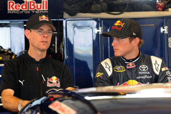 Kasey Kahne (right), driver of the No. 4 Red Bull Toyota, talks with crew chief Kenny Francis (left) in the garage during a rain delay prior to practice for the NASCAR Sprint Cup Series Quaker State 400 at Kentucky Speedway on July 8 in Sparta, Ky. (Credit: John Harrelson/Getty Images)