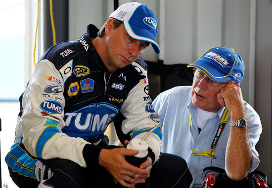 David Reutimann (left), driver of the No. 00 Tums Toyota, talks with his father Buzzy Reutimann (right) in the garage during practice for the NASCAR Sprint Cup Series Quaker State 400 at Kentucky Speedway on July 8 in Sparta, Ky. (Credit: Geoff Burke/Getty Images for NASCAR)