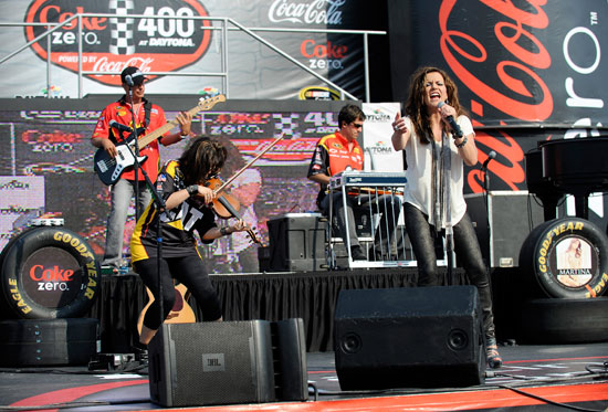 Country Music Superstar Martina McBride performs for fans prior to the NASCAR Sprint Cup Series Coke ZERO 400 Powered by Coca-Cola at Daytona International Speedway on July 2, 2011 in Daytona Beach, Florida. (Photo by Jared C. Tilton/Getty Images)