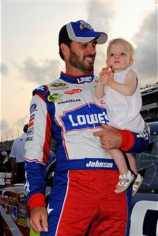 Jimmie Johnson, driver of the #48 Lowe's Summer Salute Chevrolet, holds his daughter Genevieve Marie on the grid prior to the start of the NASCAR Sprint Cup Series Coke ZERO 400 Powered by Coca-Cola at Daytona International Speedway on July 2, 2011 in Daytona Beach, Florida. (Photo by Jared C. Tilton/Getty Images)